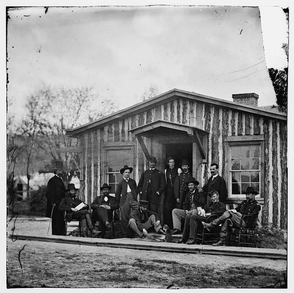 Members of Grant's staff during main eastern theater of war, siege of Petersburg, Virginia, June 1864–April 1865, with photographer Mathew Brady standing at far left (LOC)