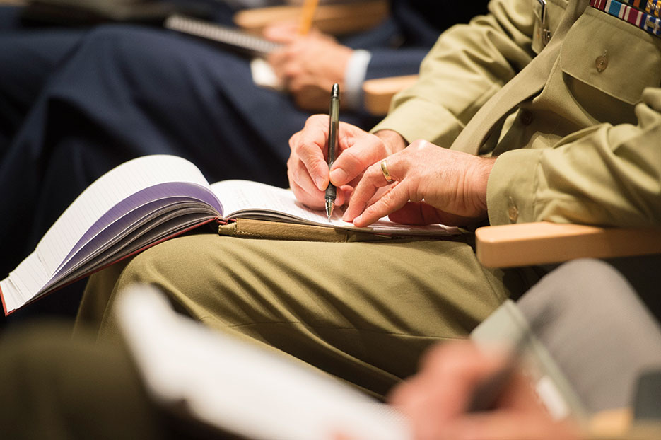 Students listen and take notes as General Dempsey speaks at Keystone course at National Defense University (DOD/Daniel Hinton)