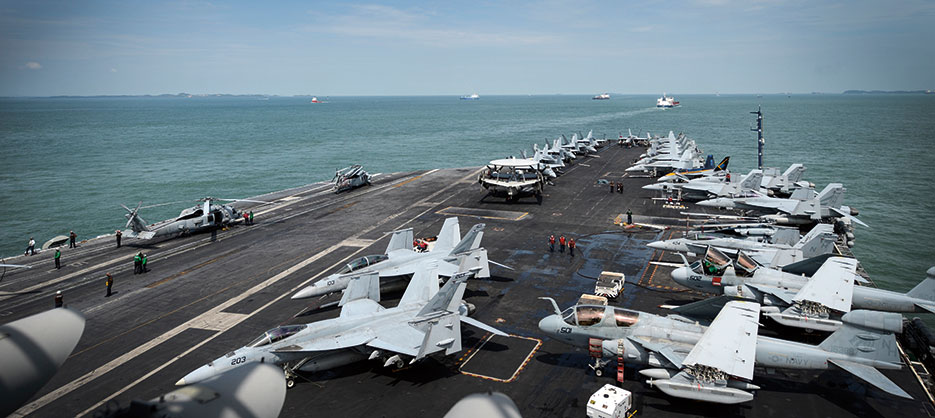 Sailors work on flight deck as aircraft carrier USS Nimitz, conducting maritime security operations and theater security cooperation efforts, transits Straits of Malacca (U.S. Navy/Derek A. Harkins)