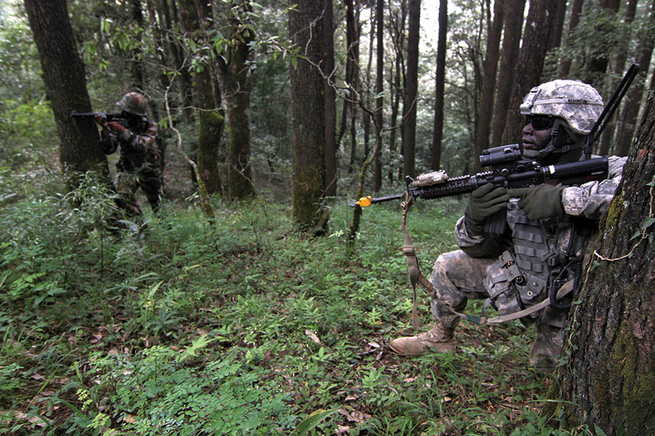 Cavalry scout and Indian army counterpart provide security for fellow soldiers during patrol through forests of Himalayas during exercise Yudh Abhyas (DOD/Mylinda DuRousseau)