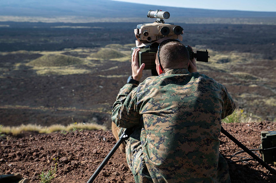 Joint terminal attack controller sights target with AN/PED-1 Lightweight Laser Designator Rangefinder to mark simulated hostile threats for air assets (U.S. Marine Corps/Devon Tindle)