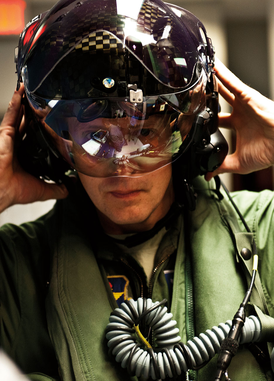 First Air Force pilot qualified to fly F-35 secures helmet prior to stepping to F-35A Lightning II joint strike fighter at Eglin Air Force Base (U.S. Air Force/Samuel King)