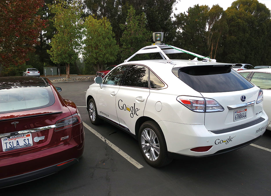 Lexus RX450h retrofitted by Google for its driverless car fleet parked near Tesla Model S electric car (Steve Jurvetson)