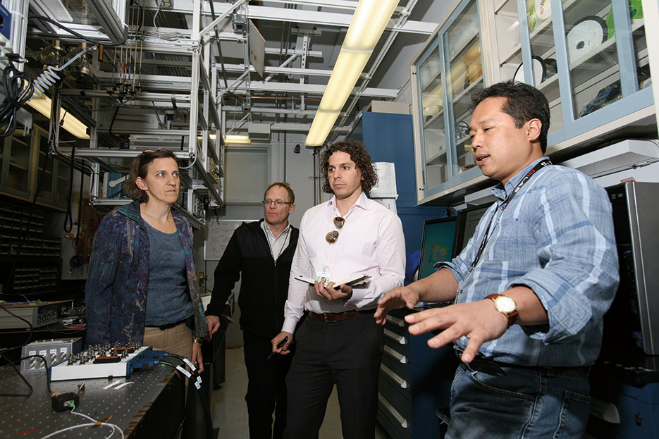 Sandia National Laboratories' Daniel Soh, right, offers overview of continuous variable quantum key distribution lab (Dino Vournas)