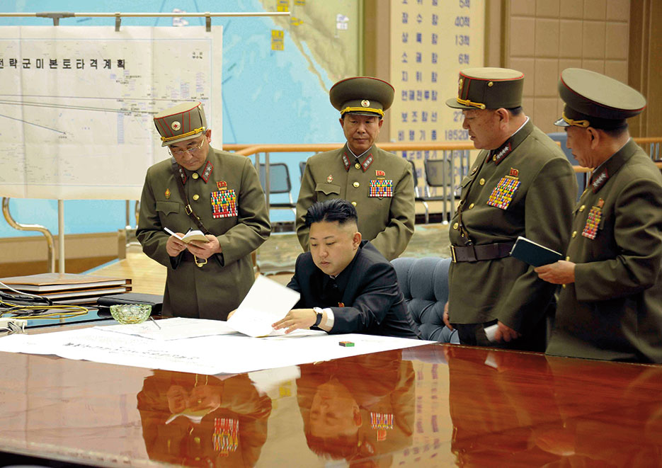 Kim Jong-un sitting at desk in what appears a dedicated military operations room (Korean Central News Agency)