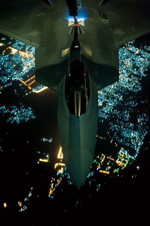 KC-10 Extender refuels F-22 Raptor over undisclosed location before targeted airstrikes in Syria to protect U.S. personnel from Islamic State in Iraq and Levant (DOD/Russ Scalf)