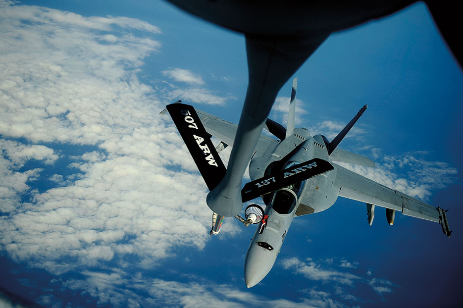 KC-135 Stratotanker assigned to 465<sup>th</sup> Air Refueling Squadron, 507th Air Refueling Wing, delivers fuel to F/A-18F Super Hornet assigned to Black Knights of Strike Fighter Squadron 154 supporting Rim of the Pacific 2010 exercises (U.S. Air Force/Kamaile O. Long)