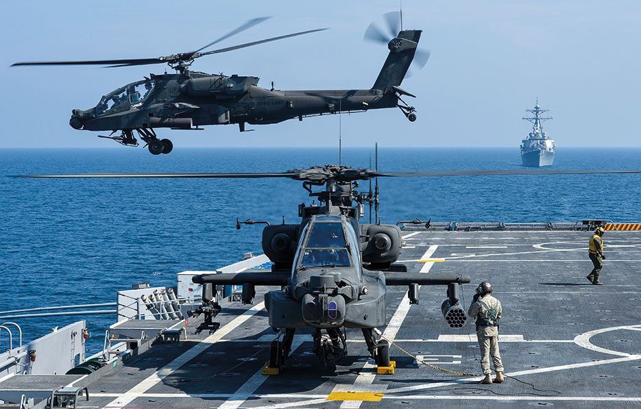 U.S. Army AH-64D Apache helicopter takes off from Afloat Forward Staging Base (Interim) USS <i>Ponce</i> during exercise, November 2012 (U.S. Navy/Jon Rasmussen)