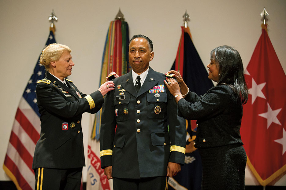 GEN Ann Dunwoody, Commanding General of Army Materiel Command, and Mrs. Linda Via promote LTG Dennis Via to rank of general during ceremony at Redstone Arsenal, Alabama, August 2012 (U.S. Army/Teddy Wade)