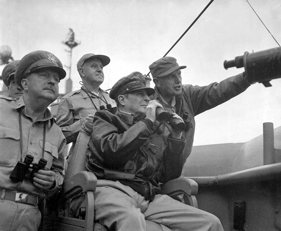 Brigadier General Courtney Whitney, General Douglas MacArthur, and Major General Edward M. Almond observe shelling of Inchon from USS <i>Mt. McKinley</span>, September 15, 1950 (NARA/U.S. Army/Nutter)