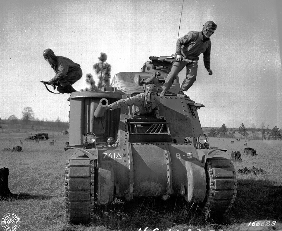 Soldiers abandon disabled M-3 tank during Third Army Louisiana Maneuvers at Camp Polk in 1943 (Signal Corps/Calvano)