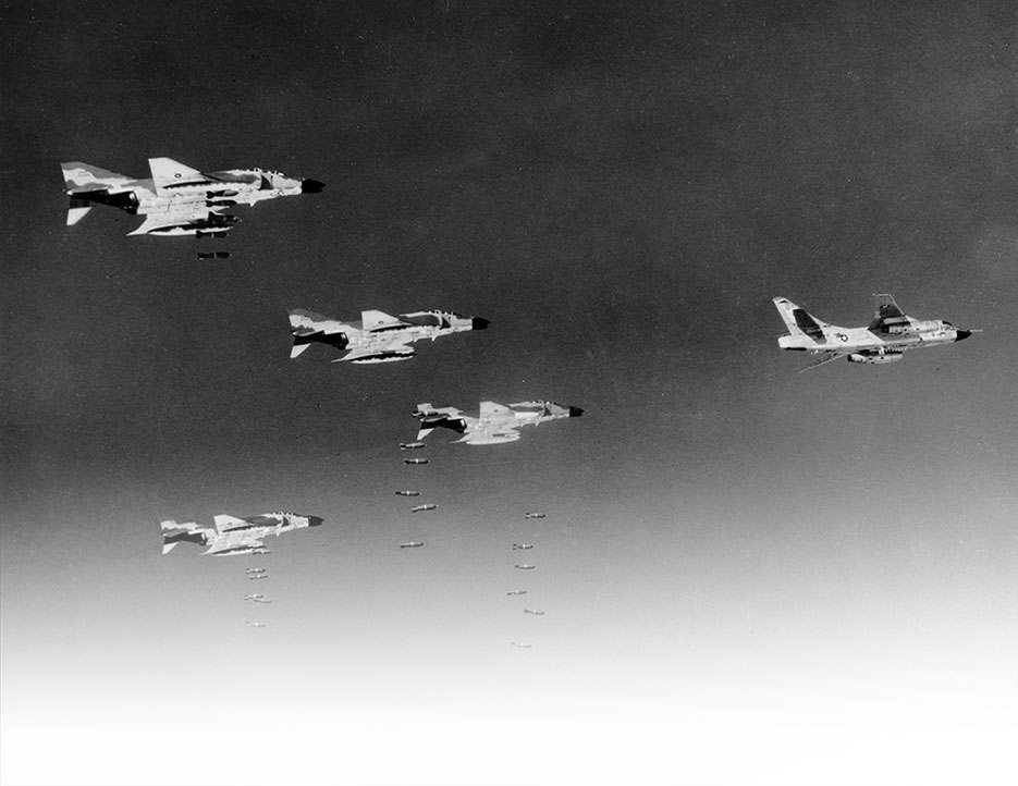 Led by RB-66 Destroyer, pilots flying Air Force F-4C Phantoms drop bombs on communist military target in North Vietnam, August 1966 (U.S. Air Force)