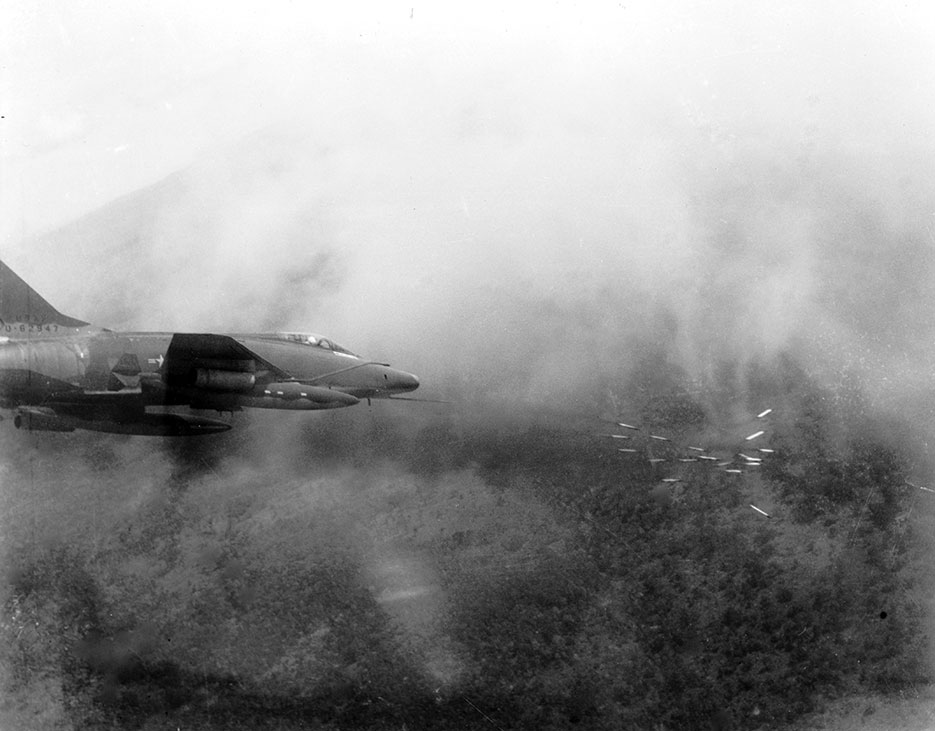 In May 1967, Air Force F-100 Super Sabre fires salvo of rockets at jungle target in South Vietnam (U.S. Air Force)