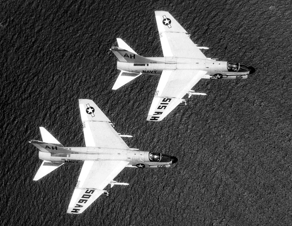 Two U.S. Navy Douglas A-7B Corsair II from attack squadron VA-25 during 1969 Ironhand mission over North Vietnam (U.S. Navy)