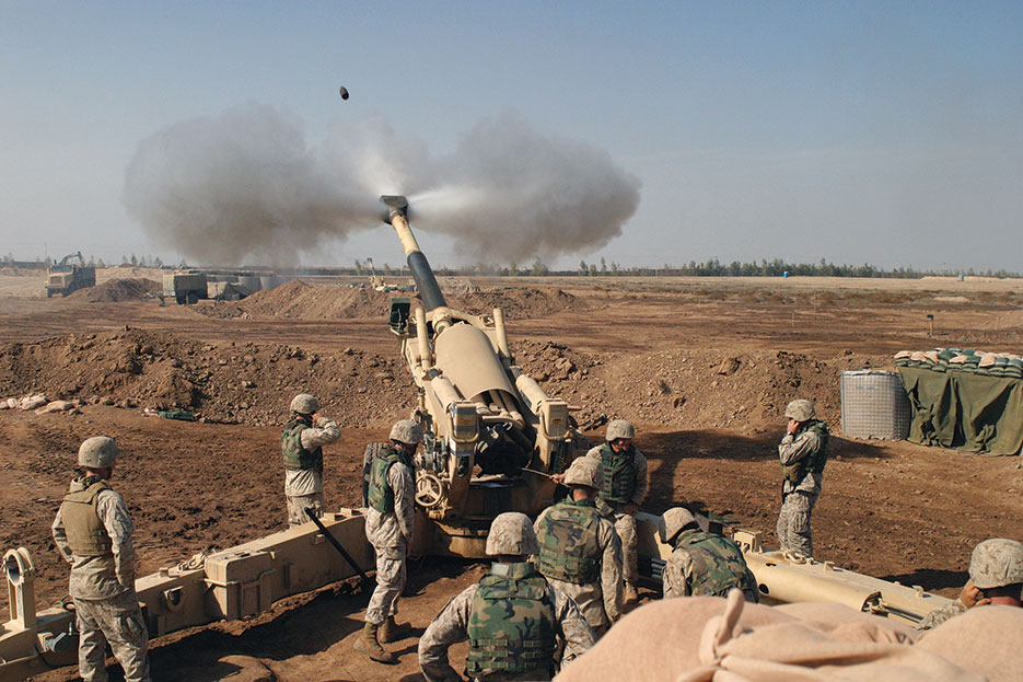 U.S. Marine Corps M-198 155mm Howitzer gun crew of 4th Battalion, 14th Marines, Mike Battery, Gun 4, at Camp Fallujah engage enemy targets November 2004 (U.S. Marine Corps/Samantha L. Jones)