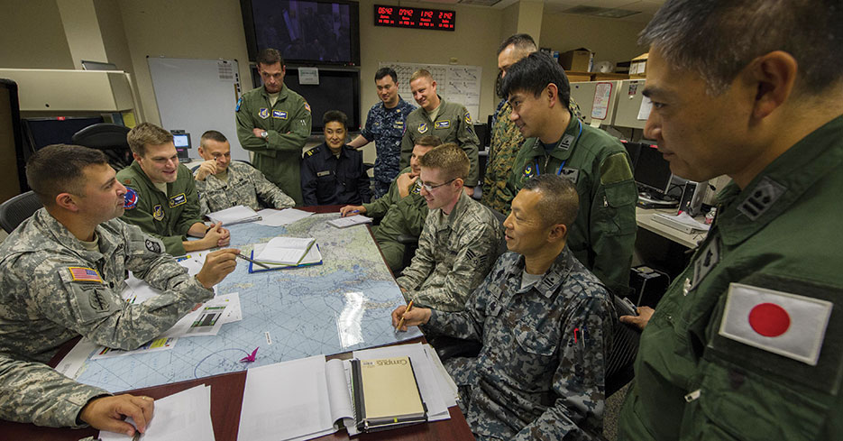 U.S. military and Japan Self-Defense Forces personnel engage in missile defense planning during Integrated Air and Missile Defense Wargame V, February 2014 (U.S. Air Force/Nathan Allen)