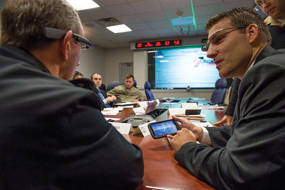 Dr. Josh Kvavle, right, demonstrates Google Glass headset for Chief of Naval Operations Admiral Jonathan Greenert during Rapid Innovation Cell meeting (U.S. Navy/Peter D. Lawlor)