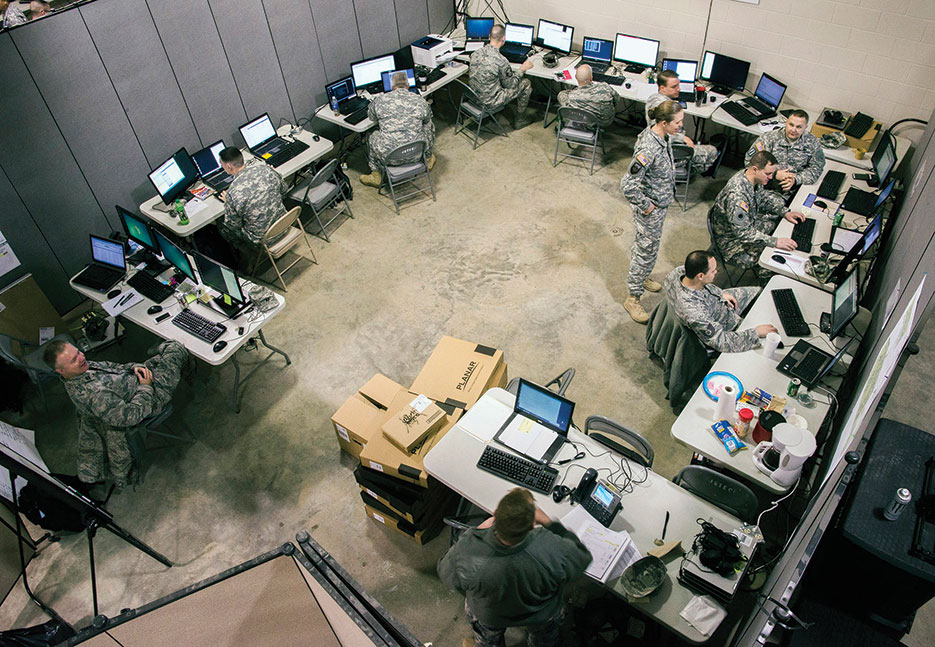 Ohio National Guard Computer Network Defense Team members conduct operations during Cyber Shield 2015, March 2015, at Camp Atterbury, IN (Ohio National Guard/George Davis)