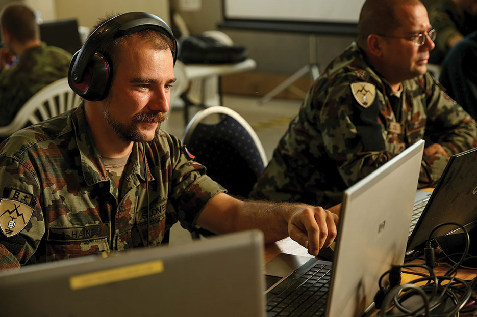 Slovenian soldier assesses mission group's response to cyber attack during Combined Endeavor 14, world's largest C4 systems exercise (U.S. Marine Corps Forces Europe/Derrick K. Irions)
