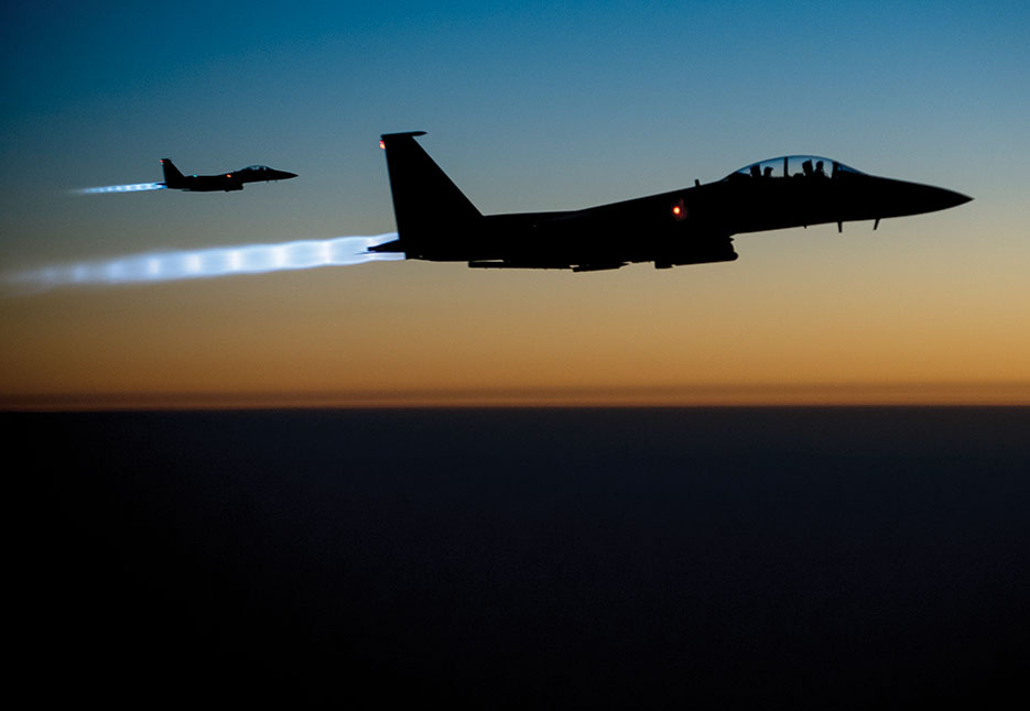 Two U.S. Air Force F-15E Strike Eagle aircraft fly over northern Iraq after conducting airstrikes against ISIL targets in Syria (DOD/Matthew Bruch)