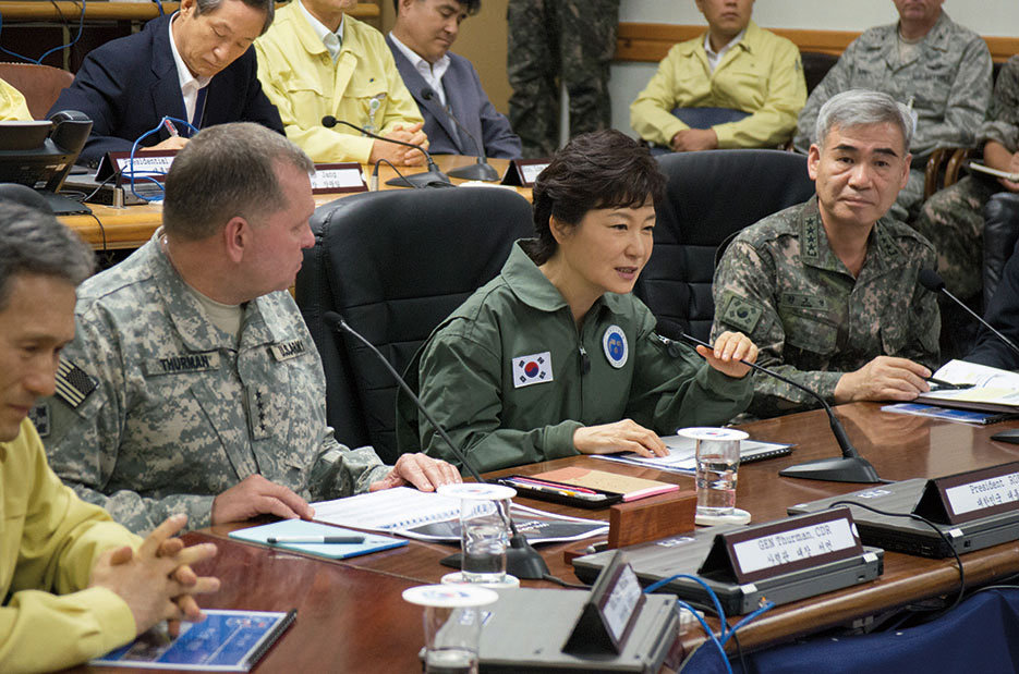 General James D. Thurman, United Nations Command, Combined Forces Command and United States Forces Korea commander, and General Kwon Oh Sung, Combined Forces Command deputy commander, brief Republic of Korea President Park Geun-hye on status of Ulchi Freedom Guardian exercise, August 22, 2013 (U.S. Army/Brian Gibbons)