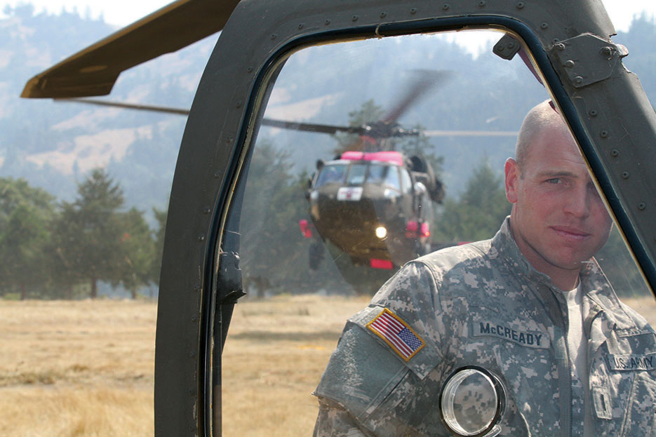 Pilot with Task Force Medevac turns his back as UH-60 Black Hawk touches down at Eel River Conservation Camp in Redway, California, August 2015 (U.S. Army National Guard/Eddie Siguenza)