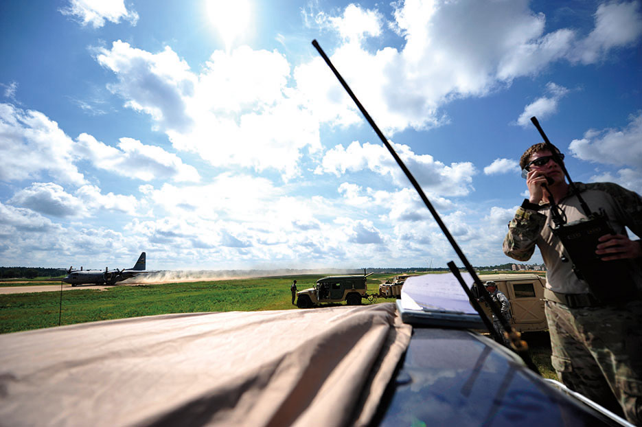 Senior Airman from 21st Special Tactics Squadron conducts air traffic control operations on edge of Geronimo Landing Zone at Fort Polk, Louisiana, during Joint Readiness Training Center rotation 13-09, August 2013 (U.S. Air Force/Parker Gyokeres)