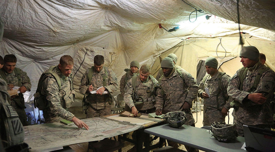 Soldiers plan for defense during decisive action rotation 15-02 at National Training Center on Fort Irwin, California, November 2014 (U.S. Army/Randis Monroe)