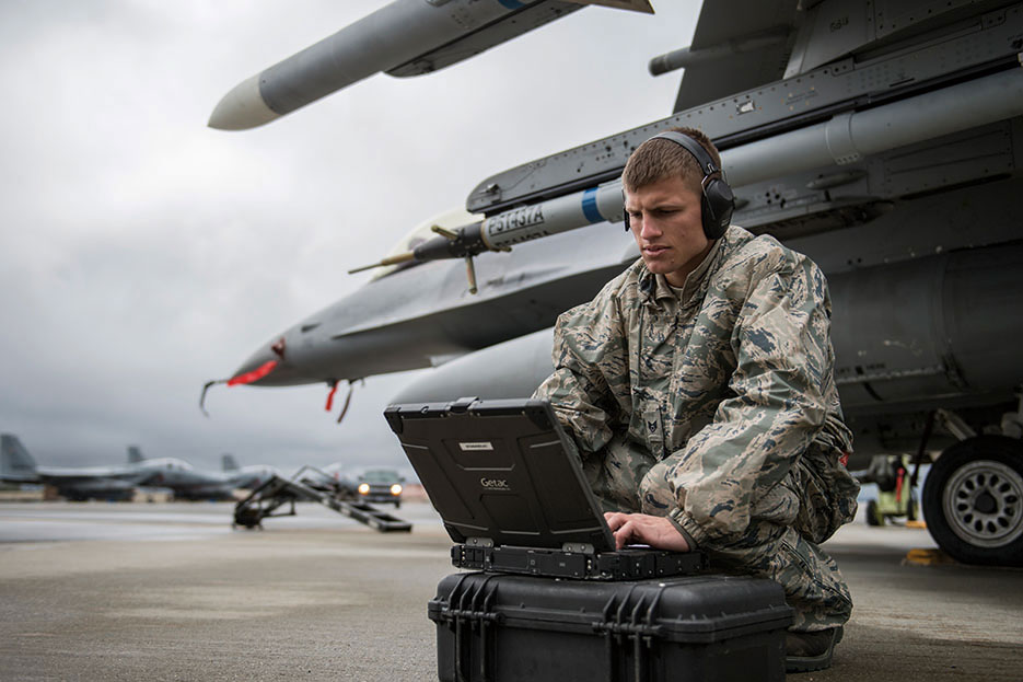 Crew chief with 36th Aircraft Maintenance Unit, Osan Air Base, South Korea, checks computer data during Red Flag-Alaska 14-2, ensuring F-16 Fighting Falcon readiness (U.S. Air Force/Peter Reft)
