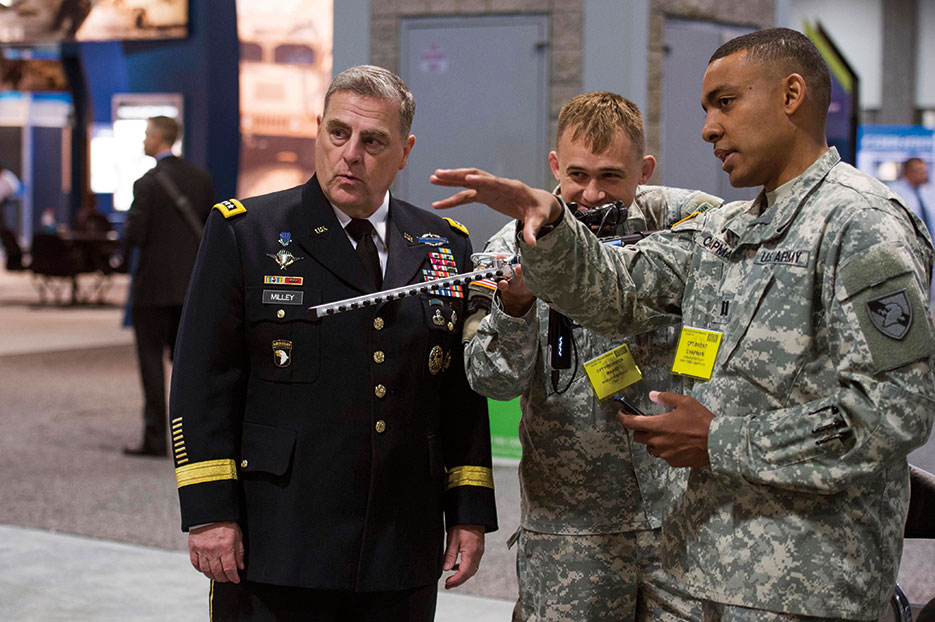 U.S. Army Chief of Staff General Mark Milley watches officers from Army Cyber Institute demonstrate Cyber Capability Rifle during 2015 Association of the U.S. Army annual meeting, Washington, DC (U.S. Army/Chuck Burden)