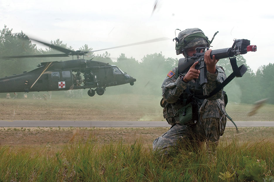 U.S. Soldier assigned to 237th Support Battalion of Ohio National Guard provides perimeter security during medical evacuation training exercise at Fort McCoy, Wisconsin, July 21, 2013 (U.S. Army/Darryl L. Montgomery)