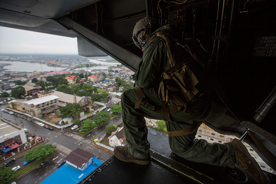 U.S. Marine assigned to Special-Purpose Marine Air-Ground Task Force Crisis Response–Africa prepares to land at U.S. Embassy in Monrovia to support