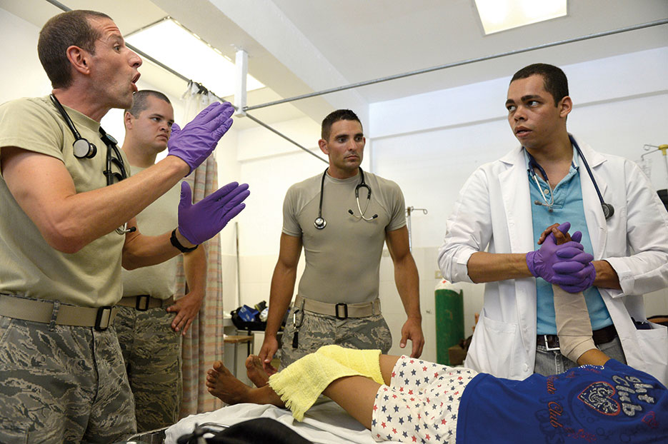 Medical team members provide emergency room support as part of New Horizons Honduras 2015 training exercise, improving joint training readiness of U.S. and partner nation civil engineers, medical professionals, and support personnel through humanitarian assistance activities, August 7, 2015 (U.S. Air Force/David J. Murphy)