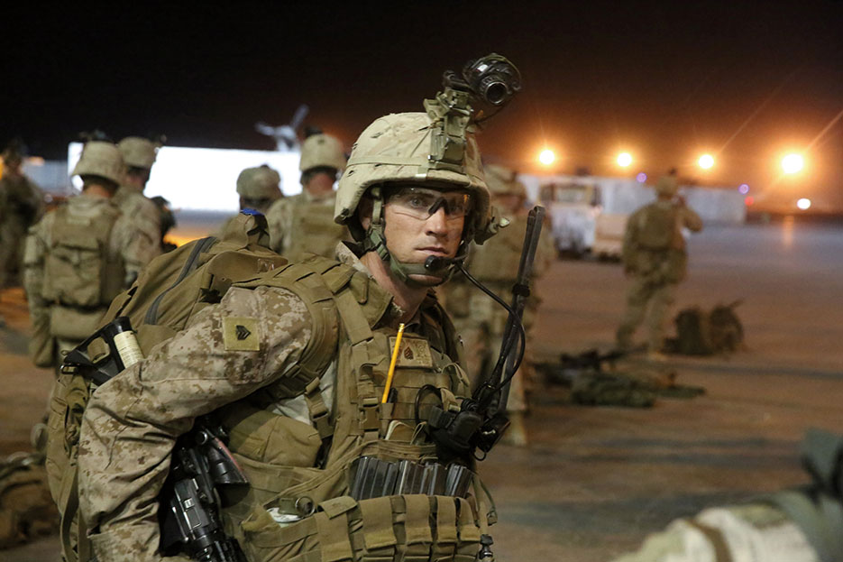 Marine with Bravo Company, 1st Battalion, 7th Marine Regiment, prepares to board CH-53E Super Stallion helicopter for mission in Helmand Province to disrupt enemy insurgents while retrograde operations take place nearby, August 16, 2014 (U.S. Marine Corps/Joseph Scanlan)