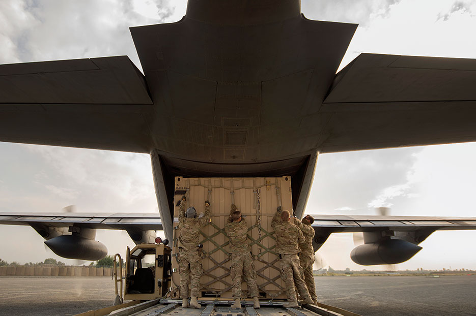 Aerial porters from 19th Movement Control Team prep shipping container for 774th Expeditionary Airlift Squadron C-130 Hercules cargo plane at Forward