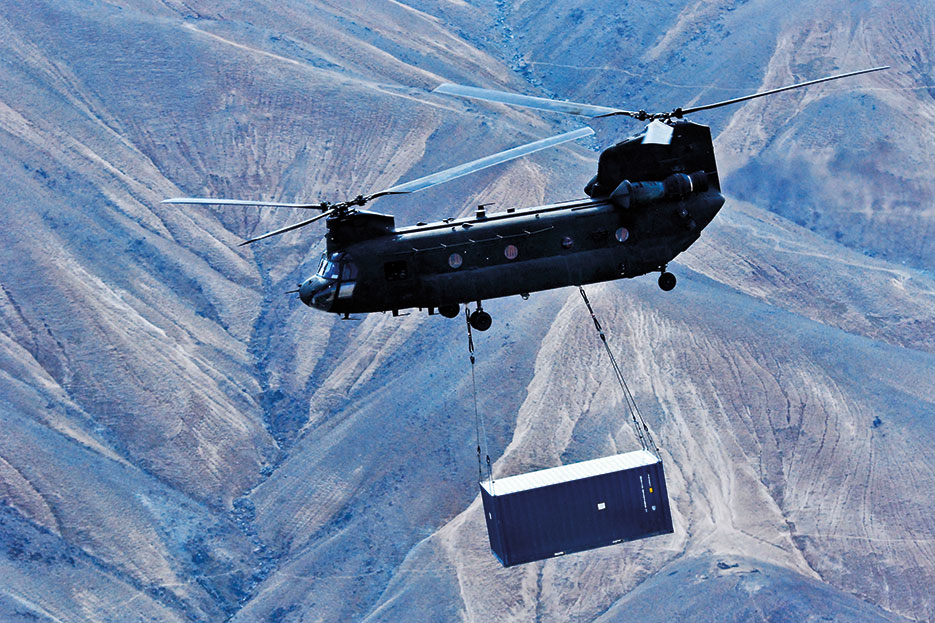 U.S. Army CH-47 Chinook helicopter operated by Soldiers with Texas and Oklahoma Army National Guard units carries sling-loaded shipping container during retrograde operations and base closures in Wardak Province, Afghanistan, October 26, 2013 (U.S. Army/Peter Smedberg)