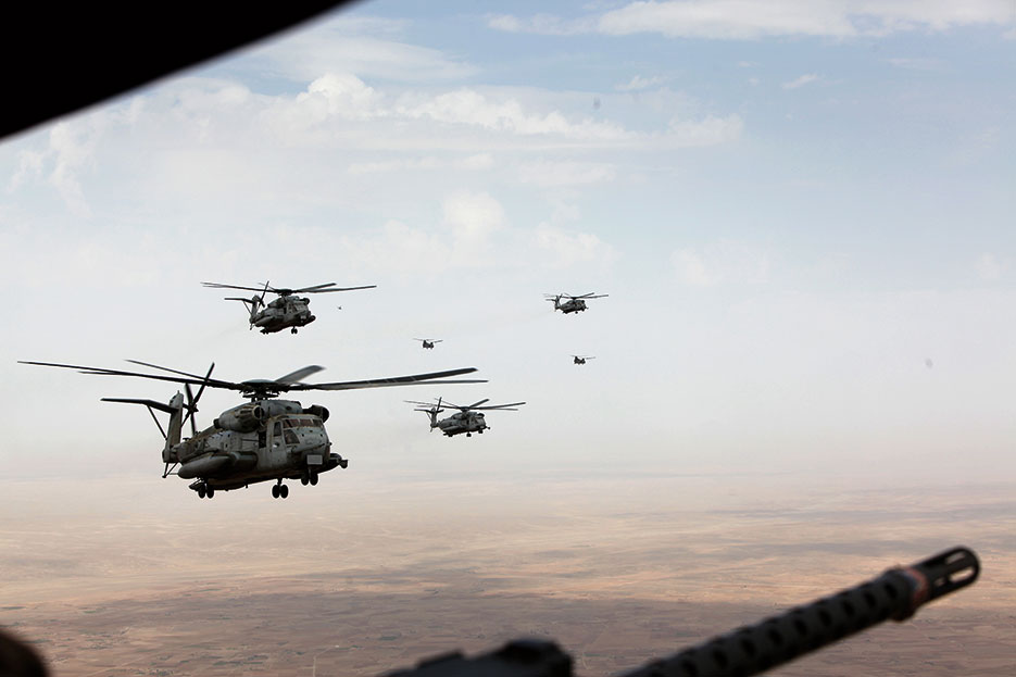 Marine Corps and Royal Air Force helicopters fly in formation after departing Camp Bastion, Afghanistan, October 27, 2014 (U.S. Marine Corps/John Jackson)