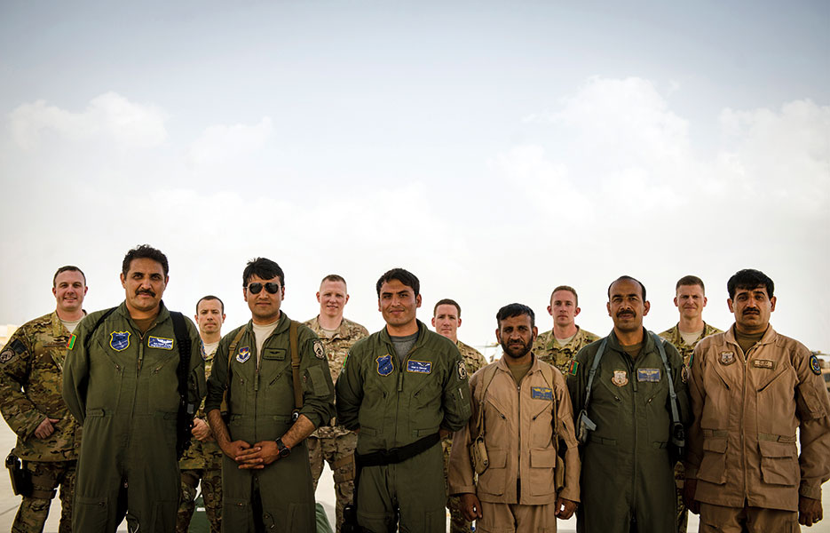 Afghan air force aircrew and NATO Air Training Command–Afghanistan air advisors stand together after first-ever all-Afghan C-130 flight, Kabul, Afghanistan, June 16, 2014 (U.S. Air Force/Vernon Young, Jr.)