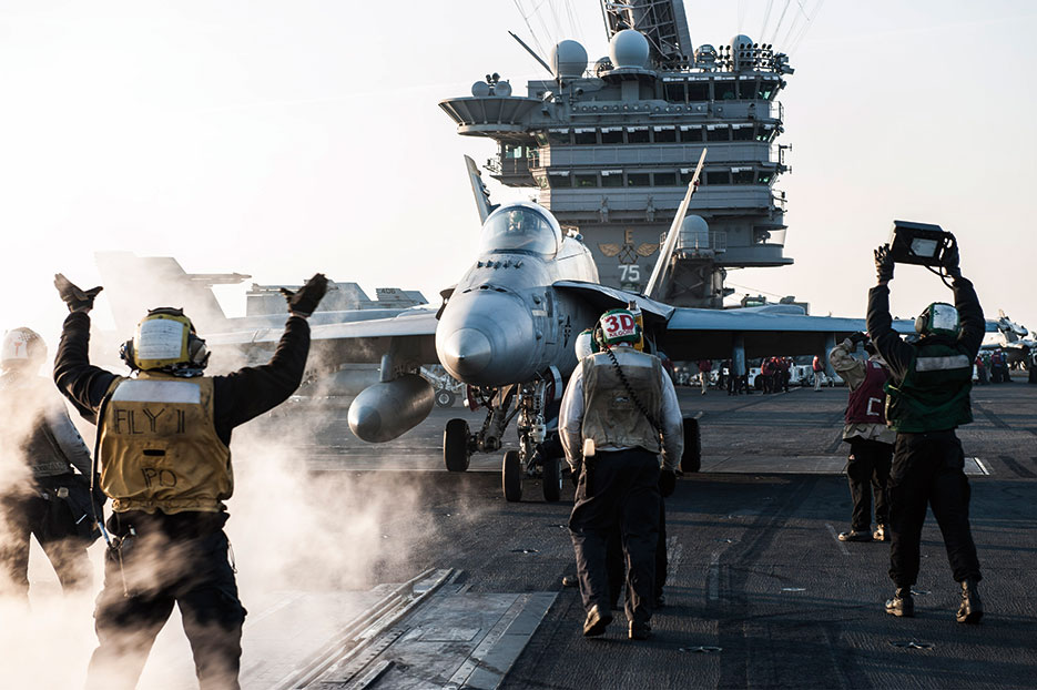 Sailors direct F/A-18C Hornet from Strike Fighter Squadron (VFA) 83 on flight deck of USS <i>Harry S. Truman</i> (CVN 75) in U.S. 5<sup>th</sup> Fleet area of operations in Arabian Gulf, February 2016 (U.S. Navy/Lindsay A. Preston)