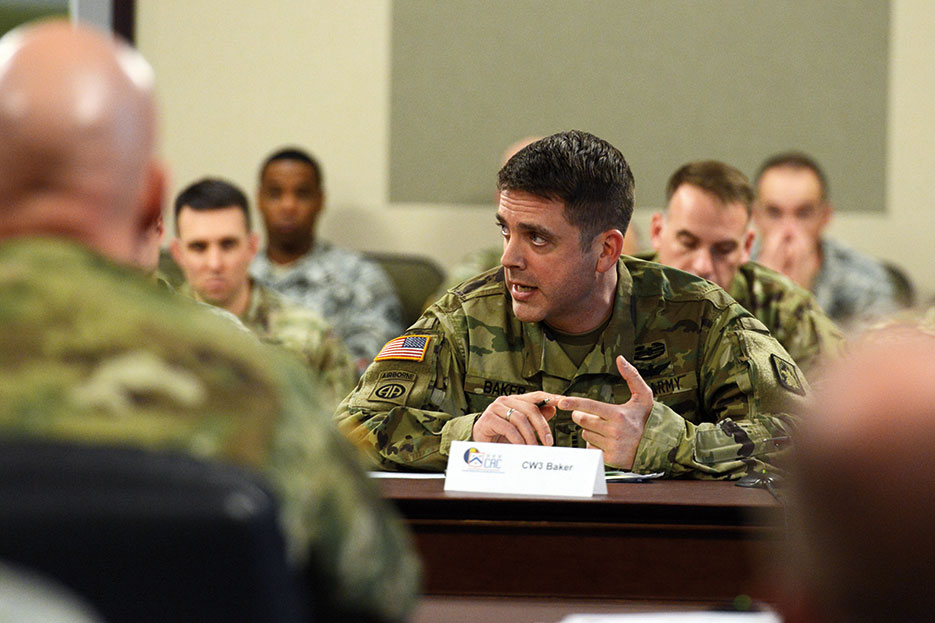 U.S. Army Warrant Officer presents team findings during Warrant Officer Solarium at Command and General Staff College, Fort Leavenworth, Kansas, January 2016 (DOD/David Vergun)