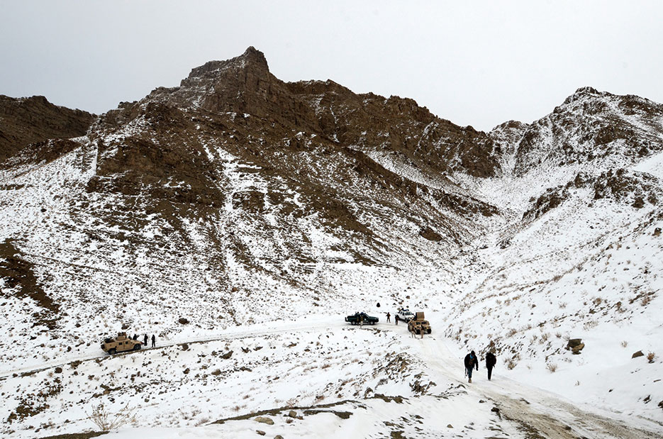 Afghan police officers and Afghan National Security Forces move up mountain pass in Paktika Province, Afghanistan, January 2014 (DOD/Jared Gehmann)