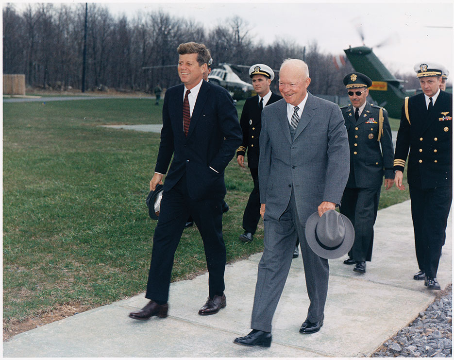 President Kennedy, President Eisenhower, and military aides at Camp David, Maryland, April 22, 1961 (Robert L. Knudsen/U.S. National Archives and Records Administration)
