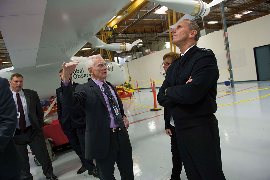 Chairman and CEO of AeroVironment briefs Chief of Naval Operations Admiral Jonathan Greenert on capabilities and potential applications of Global Observer, a long-range, long-duration UAV, Simi Valley, California, November 2014 (U.S. Navy/Peter D. Lawlor)