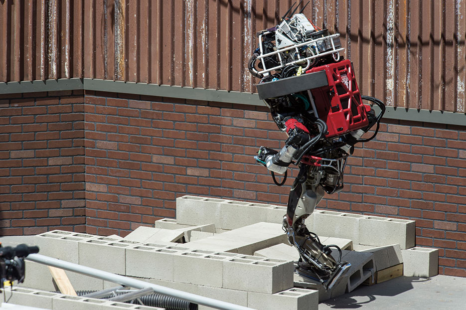 WARNER, a teaming of Worcester Polytechnic Institute and Carnegie Mellon University, navigates debris field during DARPA Robotics Challenge in Pomona, California, June 2015 (U.S. Navy/John F. Williams)