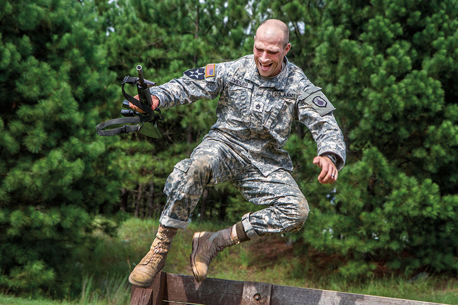 Staff Sergeant Russell Vidler, USA, leaps over wall at Fit to Win obstacle course on Fort Jackson, South Carolina, September 2015 (U.S. Army/Brian Hamilton)