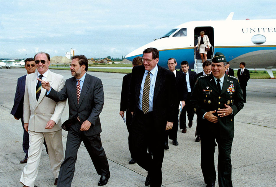 NATO Secretary General Javier Solana and General George Joulwan meet at Brussels airport with Richard Holbrooke en route for Bosnia as Special Envoy for President Clinton (NATO)
