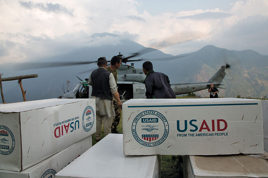 Relief supplies from USAID unloaded off Marine Corps UH-1Y Venom from Joint Task Force 505 in remote area of Nepal during Operation <i>Sahayogi Haat</i> (U.S. Marine Corps/Hernan Vidana)