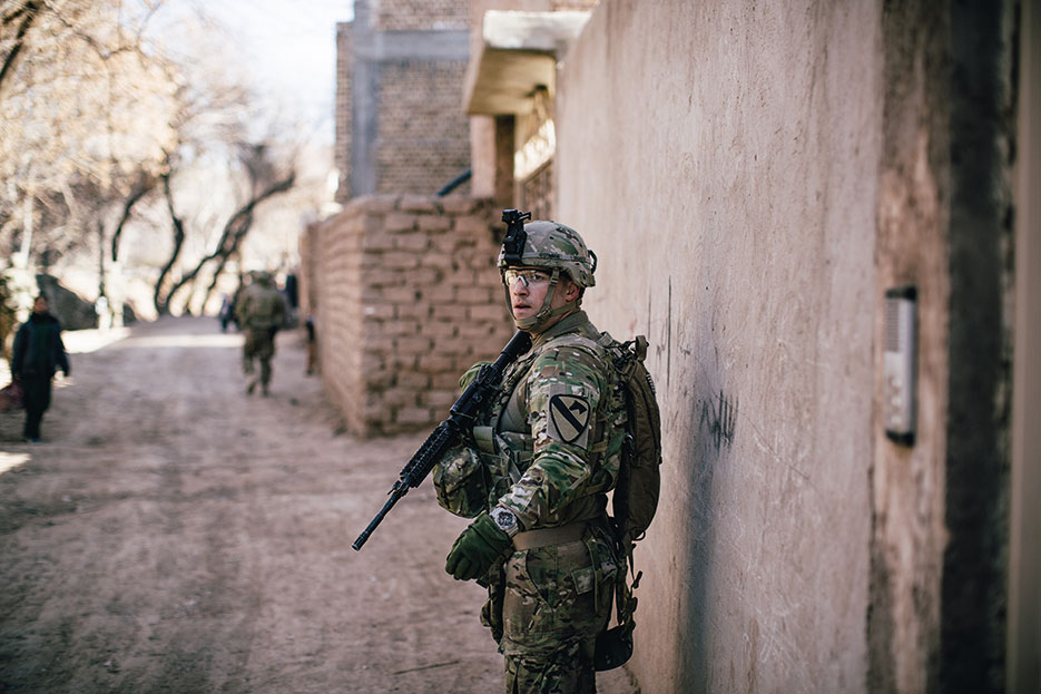 Soldier assigned to Delta Company, 1<sup>st</sup> Squadron, 8<sup>th</sup> Cavalry Regiment, 2<sup>nd</sup> Brigade Combat Team, 1<sup>st</sup> Cavalry Division, conducts presence patrol around U.S. Consulate in Herat, Afghanistan, January 2014 (U.S. Army/Alex Flynn)