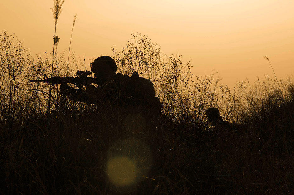 Marines post security on patrol during Forest Light 15-1 at Oyanohara Training Area in Yamato, Kumamoto Prefecture, Japan (U.S. Marine Corps/Warren Peace)