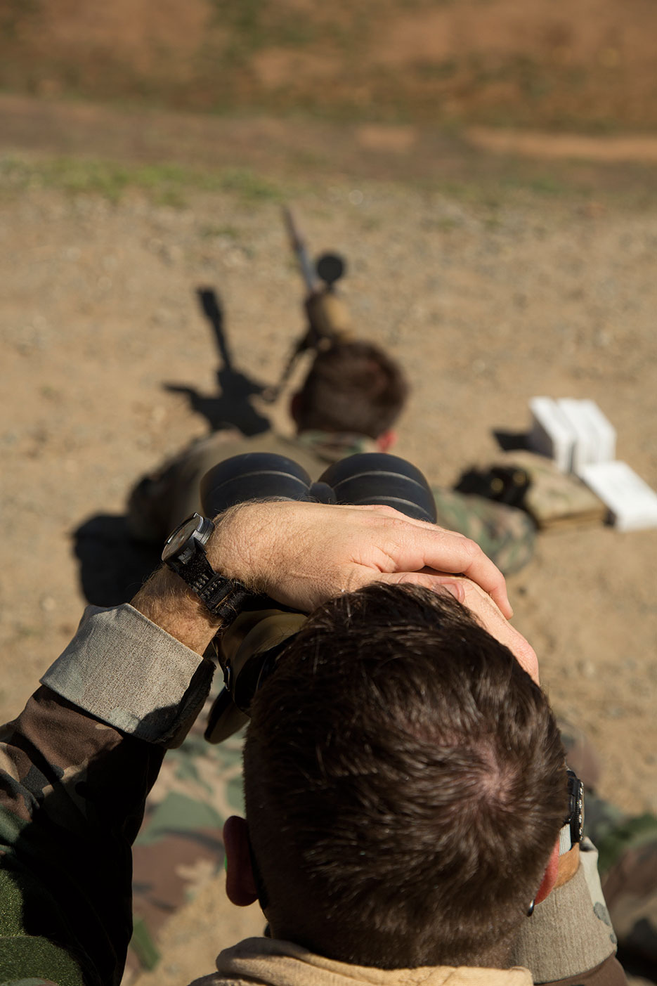 Marine spots for his teammate, who is firing at distant, static targets on range aboard Marine Corps Base Camp Pendleton, California, October 2015 (U.S. Marine Corps)